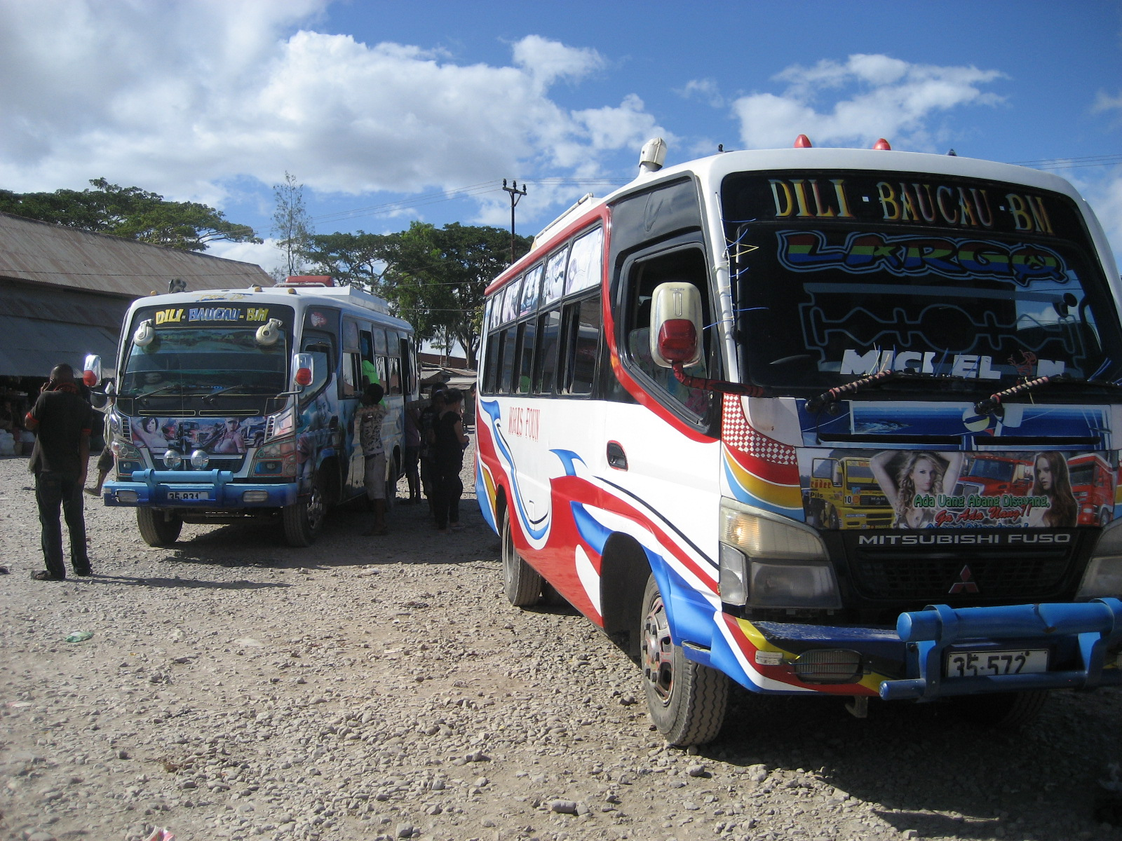 Mini buses at the bus station in Bacau, East Timor