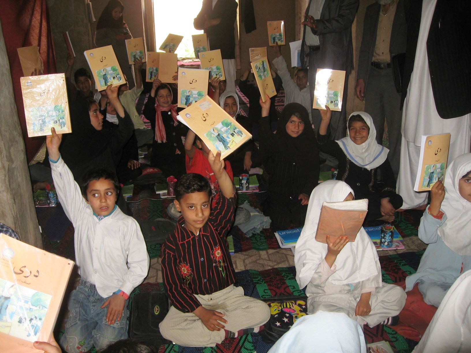 School books being used by children at school in Herat, Afghanistan